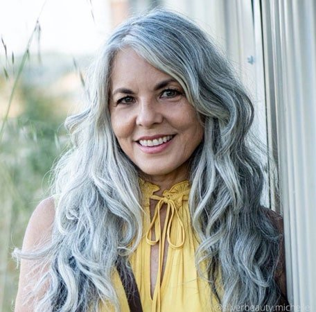 image of woman with long gray curls over 50
