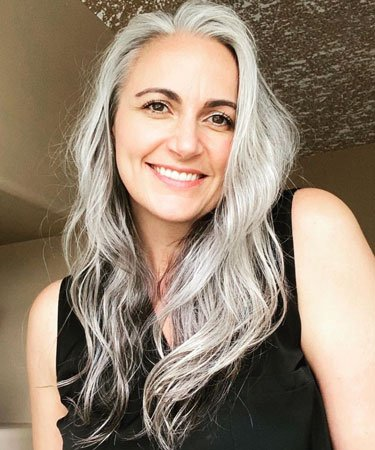 image of woman with wavy grey hair