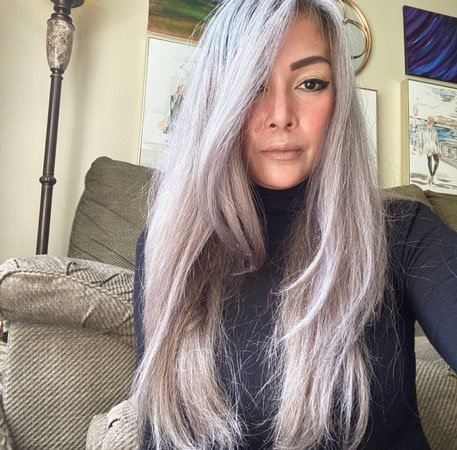 image of woman with long gray hair