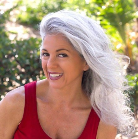 image of woman with long gray hair over 50