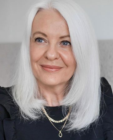 image of woman with white hair over 50