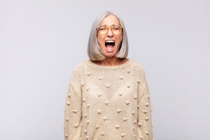 image of shouting woman gray hair
