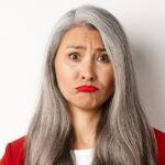 image of sad woman with gray hair